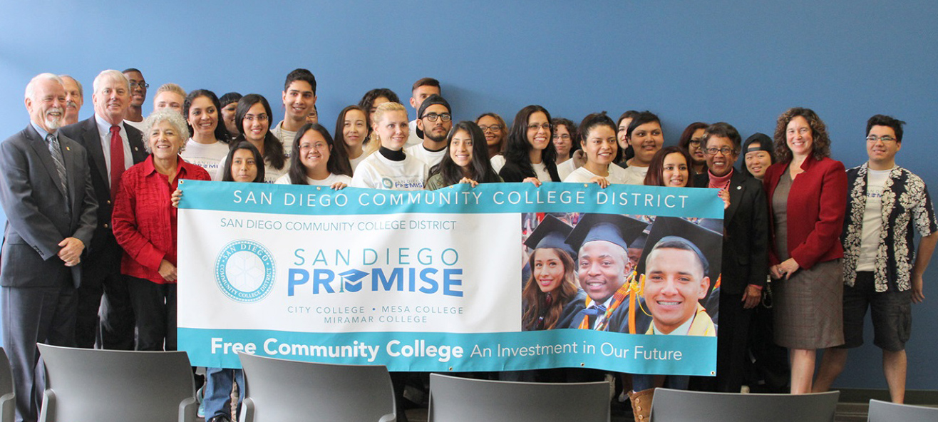Students in the Promise Program hold up a San Diego Promise banner