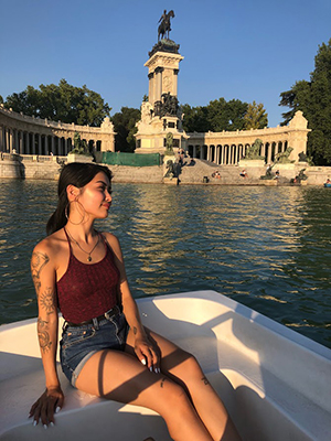 Allison Tjan on a boat in Parque de Buen Retiro in Madrid.