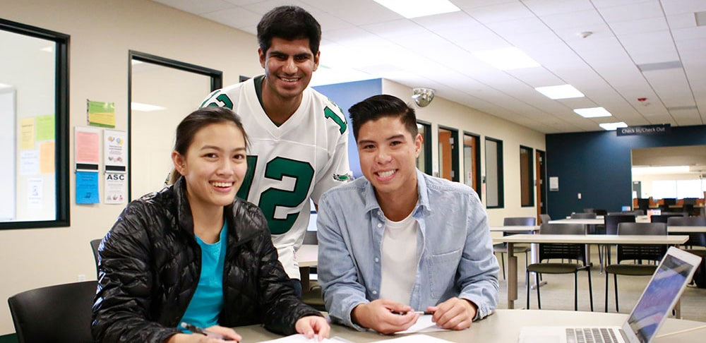Three students studying at a table at mesa college