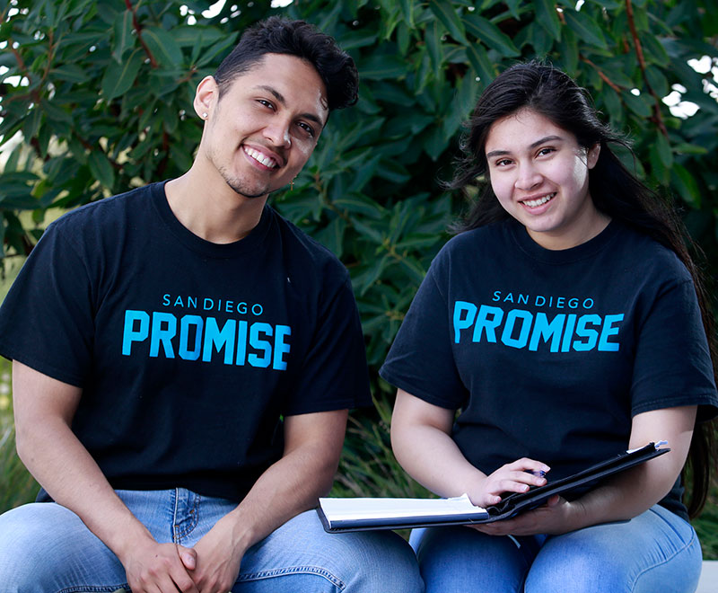 Two promise students wearing promise t-shirts