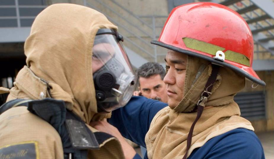 trainees put on fire protection gear